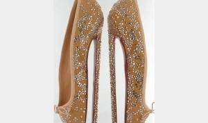 Кристиан Лабутен создал самые высокие туфли на шпильках